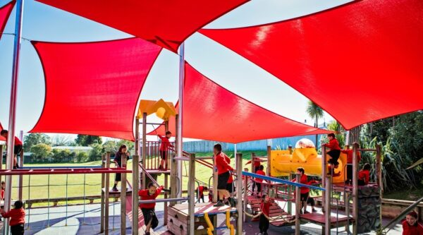 Triangle and square shade sails over playground by Sunnyside
